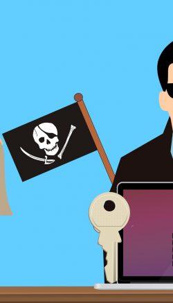 Ilustração de um hacker tomando conta de um computador, com uma bandeira de pirata e uma mão com um saco de dinheiro como pagamento de resgate